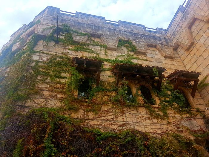 Abandoned building against sky