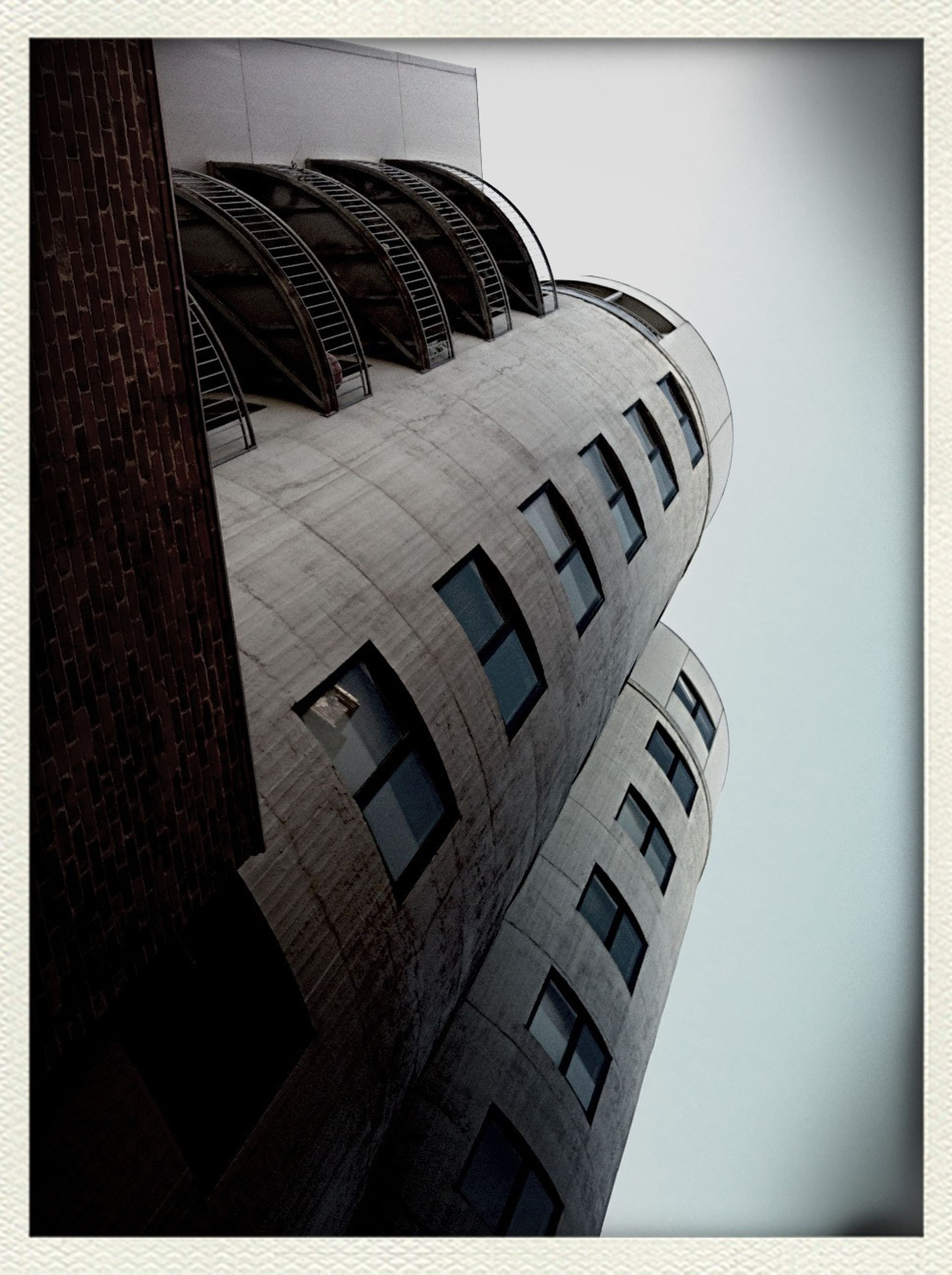 architecture, building exterior, built structure, low angle view, transfer print, auto post production filter, window, building, clear sky, pattern, day, modern, no people, sky, city, office building, outdoors, glass - material, sunlight, residential building