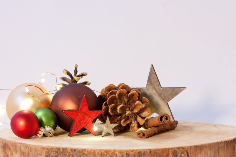 Cinnamon Gold Colored Red Color Wooden Celebration Christmas Lighting Equipment Backgrounds Merry Christmas! Christmas Lights Pine Cone Stars No People Copy Space Food Food And Drink Spice Studio Shot Christmas Ornament Decoration Indoors  Holiday Christmas Decoration Still Life Holidays