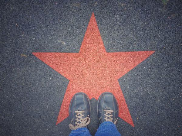 Red Star on Black Background Playground Feet