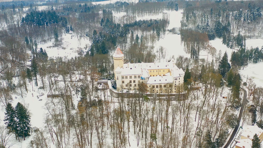High angle view of building by lake during winter