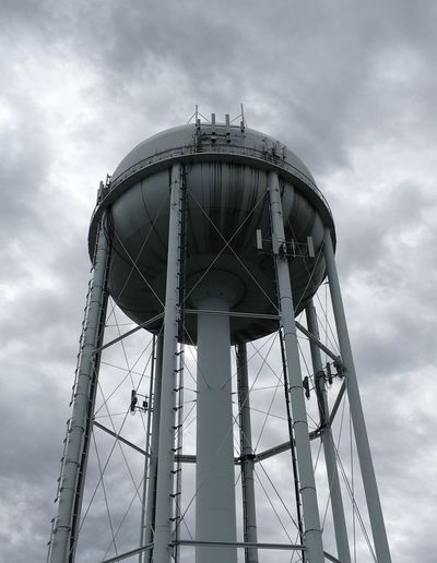A water tower on a cloudy day. Water Is Life Ecology Is Survival Water Tower From Below Water Tower Cloudy Sky Town Water Tower Clouds In Sky EyeEm Selects Sky Cloud - Sky Low Angle View Built Structure Architecture Water Tower - Storage Tank Tower Metal Storage Tank Water Conservation