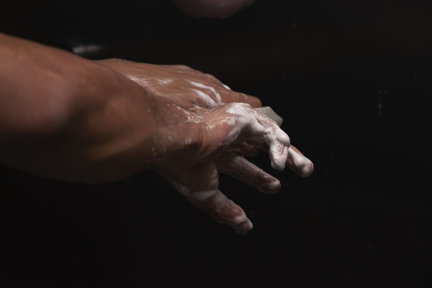 Surgeon scrubbing hands before surgery Doctor  Hospital Hygiene Surgeon Washing Antibacterial Antiseptic Body Part Clean Finger Hand Human Body Part Human Hand Men One Person Operating Room Operation Real People Scrubbing Soap Sterile Surgery Theatre Water