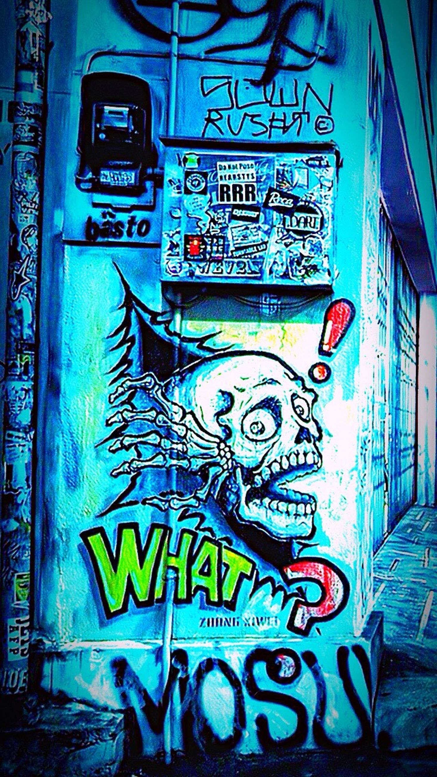 graffiti, text, western script, communication, wall - building feature, art, built structure, creativity, street art, art and craft, capital letter, architecture, non-western script, vandalism, blue, multi colored, transportation, wall, information sign, indoors