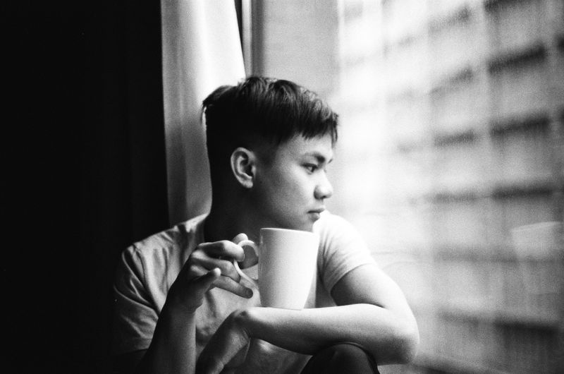 Portrait of boy looking away while sitting at home