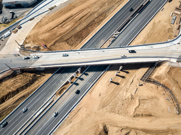 Grand Terrace, CA / USA - 4/07/2019: The Barton Road / 215 Interchange Under Construction Transportation Road Mode Of Transportation High Angle View Land Vehicle Highway Motor Vehicle No People Car Day City Travel Motion Multiple Lane Highway Nature Street Architecture Land Outdoors Commercial Land Vehicle Freeway Bridge Bridge - Man Made Structure Pillars Concrete Asphalt Overpass Caltrans Overhead View Dronephotography