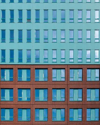 Architecture Built Structure Window Building Exterior Blue Full Frame Building No People Day Pattern Low Angle View Backgrounds City Glass - Material Side By Side In A Row Outdoors Office Building Exterior Repetition Reflection