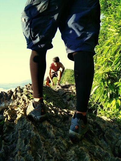 @Mt. Hapunang Banoy, Philippines. My co-hiker is climbing up and spotted him between the legs of my friend. Hikerslife Hikers Hike Rock Formation Rocky Mountains Eyeem Philippines Mountain Hiking Mountain Climbing Adventure Club