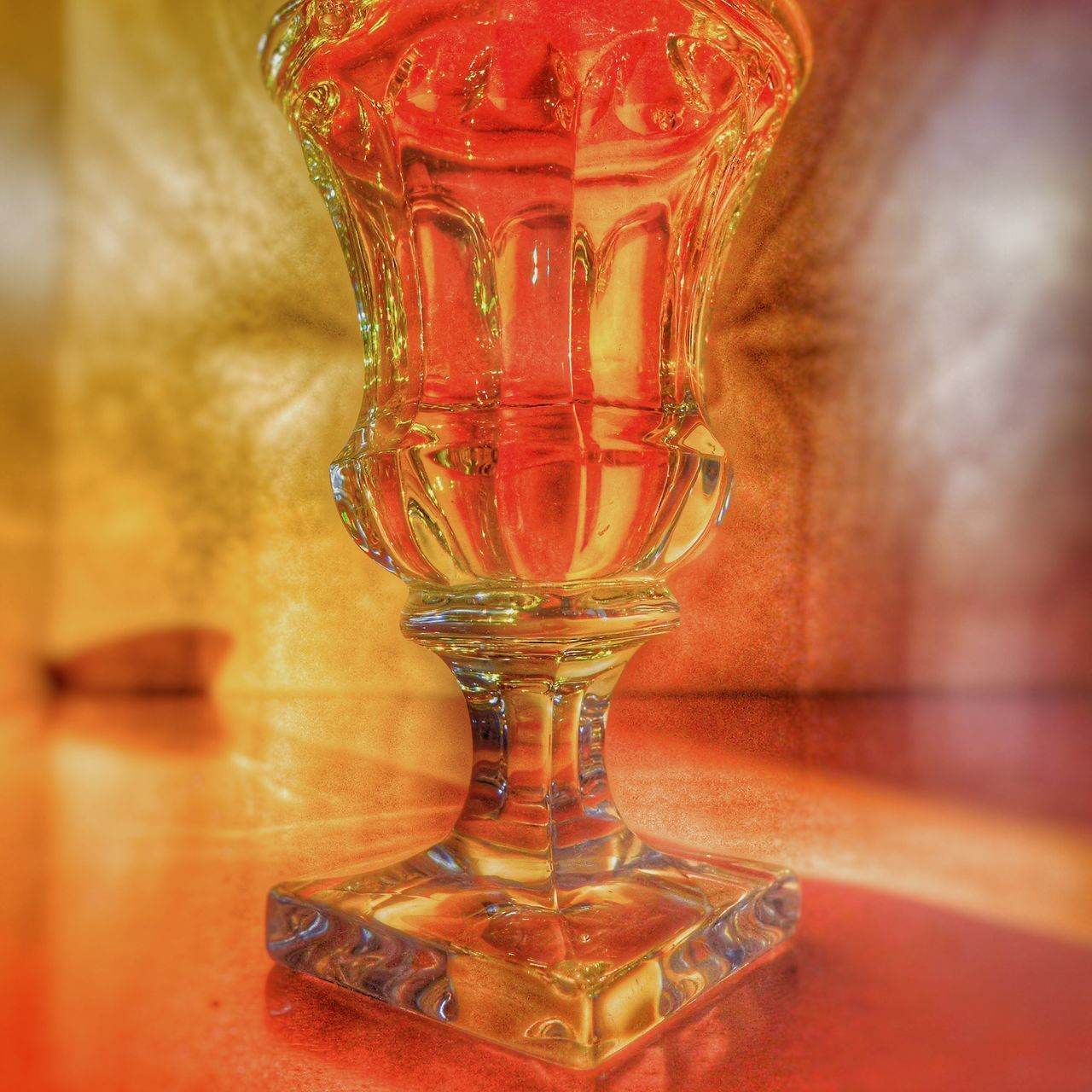 indoors, close-up, glass, red, table, no people, transparent, drinking glass, still life, glass - material, household equipment, refreshment, food and drink, drink, pattern, reflection, freshness, selective focus, design, alcohol, crockery