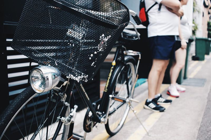 Close-up of bicycle parked at street