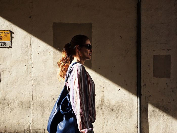 One Person Street Light And Shadow Sunlight Young Women Streetphotography Shadow Redhead The Street Photographer - 2017 EyeEm Awards Tranquility Walking Architecture Tranquil Scene in Leeds Live For The Story BYOPaper! Place Of Heart Paint The Town Yellow Second Acts Be. Ready. EyeEm Ready