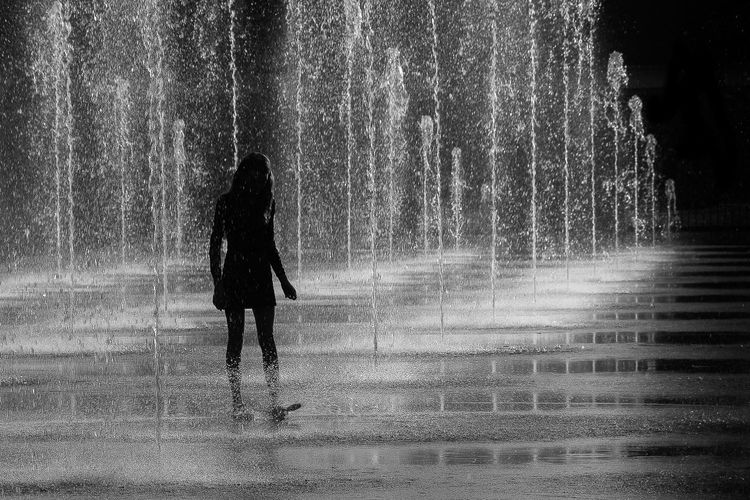 Walking Real People One Person Rear View Wet Day Silhouette Outdoors Women People Water First Eyeem Photo EyeEmNewHere Bnw Art Is Everywhere TCPM The Street Photographer - 2017 EyeEm Awards BYOPaper! Girl Live For The Story Rethink Things