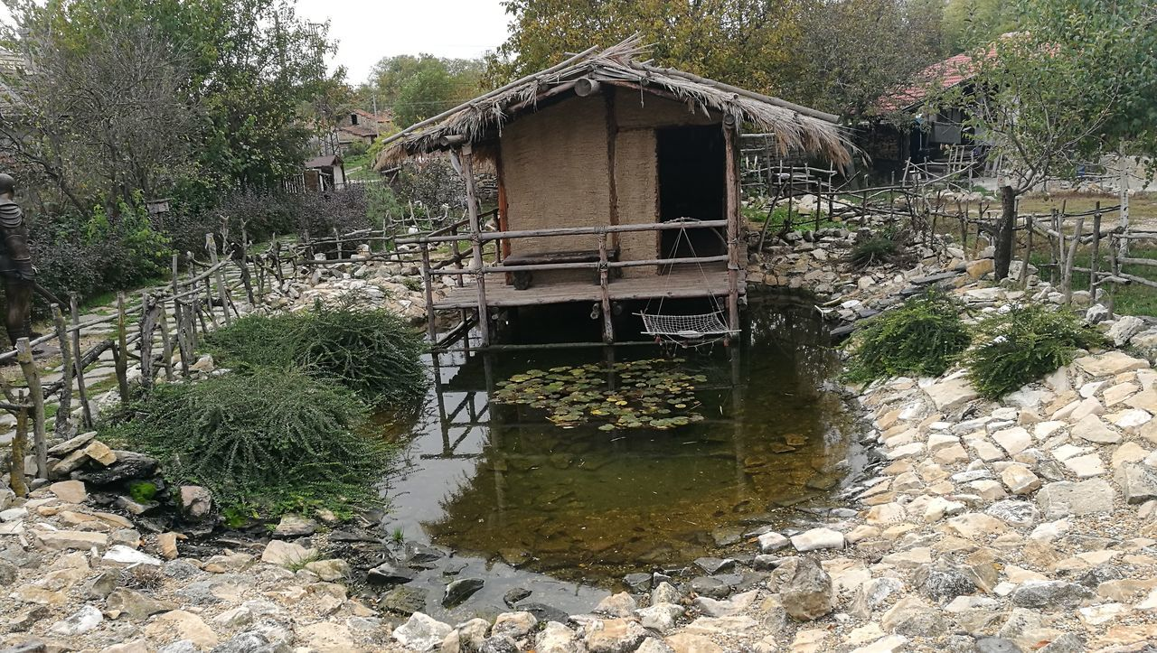 architecture, built structure, water, stilt, day, no people, outdoors, tree, plant, stilt house, nature, building exterior, watermill