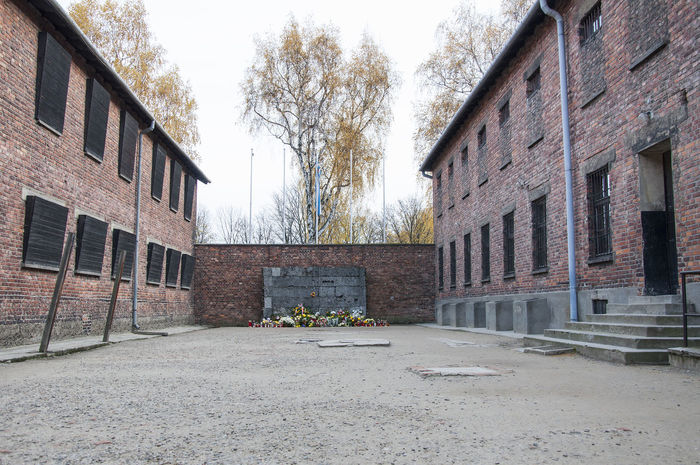 Auschwitz concentration camp (German: Konzentrationslager Auschwitz, also KZ Auschwitz) was a network of German Nazi concentration camps and extermination camps built and operated by the Third Reich in Polish areas annexed by Nazi Germany during World War II. It consisted of Auschwitz I (the original camp), Auschwitz II–Birkenau (a combination concentration/extermination camp), Auschwitz III–Monowitz (a labor camp to staff an IG Farben factory), and 45 satellite camps. Auschwitz  Auschwitz Birkenau Auschwitz Memorial Birkenau Birkenau Memorial Concentration Camp Concentrationcamp Poland