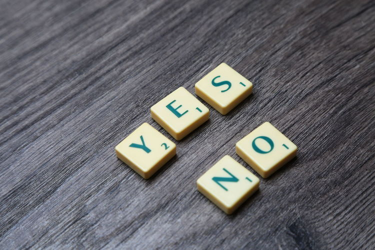 YES NO text Alphabet Backgrounds Close-up Communication Contrast Day Education Font Game Grey Background High Angle View Indoors  Motivation Motto No No People Number Presentation Scrabble Strategy Table Text Wood - Material Yes Letters