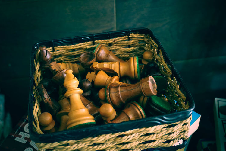 Close-up of chess pieces in basket