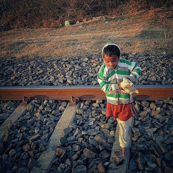 A young Indian girl crosses the railway track with a kitten in Ranchi, Jharkhand, India. Everydayeverywhere Dailylife Photojournalism Journalism Reportage Reportagespotlight Hufgpostgram Indiaphotoproject Onepluslife Oneplus2 Myfeatureshoot Ranchi Jharkhand India ASIA