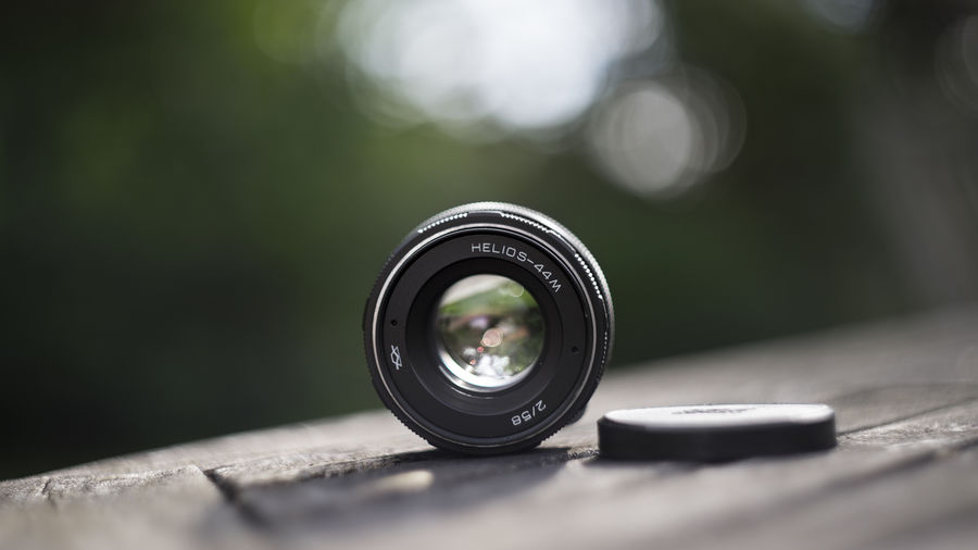A picture of a Helios 44M with a Helios 44M :) 58mm Bokeh Close-up Composition Day Detail Elements Glass Green Helios Helios 44M Helios 44M 58mm F2 Lens Light Nature No People Outdoors Part Of Portrait Russia Selective Focus Summer Swirly Ussr Zenit