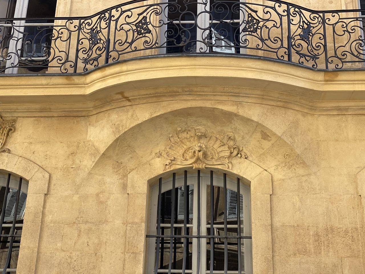 architecture, built structure, building exterior, window, building, low angle view, no people, day, arch, ornate, the past, history, wall - building feature, pattern, railing, design, balcony, outdoors, art and craft, architectural feature, wrought iron, bas relief, floral pattern