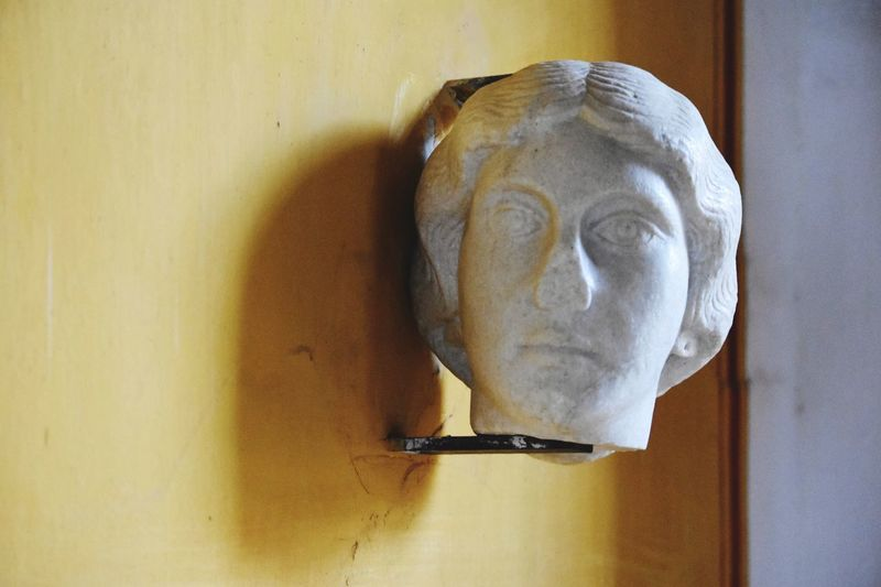 Roman Sculpture Ancient History Textures And Surfaces Respect For The Good Taste EyeEm Best Shots Let's Do It Chic! Eye4photography  Exceptional Photographs Stone Sculpture Close-up HEAD Rustic Style Tranquility Shadows & Lights Yellow Wall White Stone Lieblingsteil