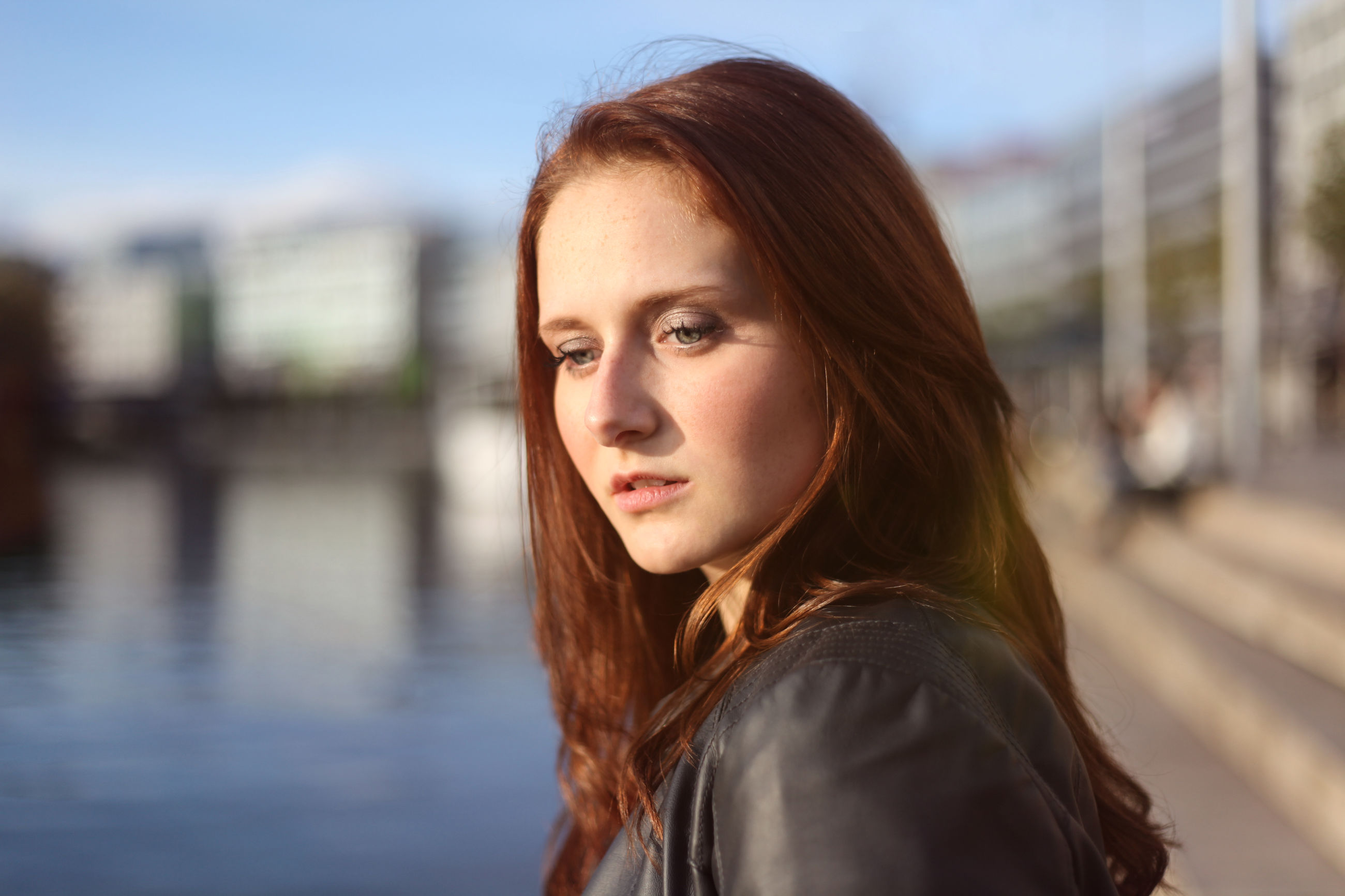 long hair, focus on foreground, water, young adult, headshot, young women, lifestyles, brown hair, front view, looking at camera, sea, person, casual clothing, beauty, outdoors, day, city life, waterfront