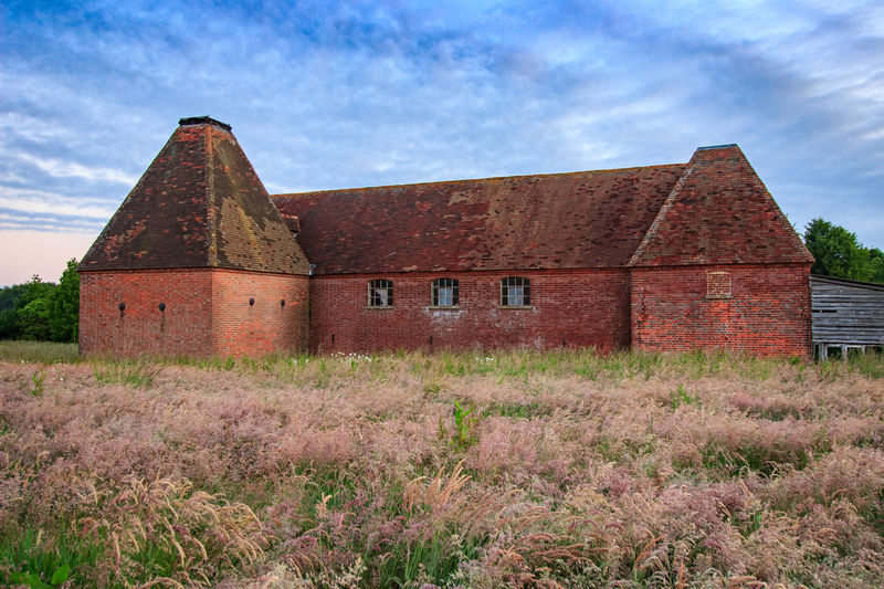 Oast House, Garden Of England, Kent, England. Architecture Sky Built Structure Nature No People Plant Hops Beer Brewing Iconic Buildings Vivid International Getty Images EyeEm Gallery Travel Destinations Tourism Sunrise Countryside Rural Scene History Building Exterior Building Cloud - Sky Field Land Day House Old Grass Landscape Outdoors The Past Abandoned