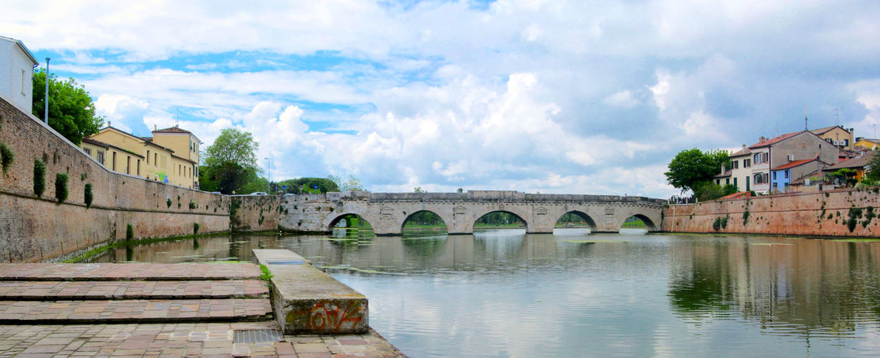 Ponte di e Bridge of Tiberius crossing the Marecchia river. Historical Arch Tiberius Bridge Ancient Crossing Cityscape Old Travel Ponte Italy City Marecchia Landmark Tourism Walls Architecture Water River Rimini Monument Arcade Europe Building Reflection Sky First Eyeem Photo