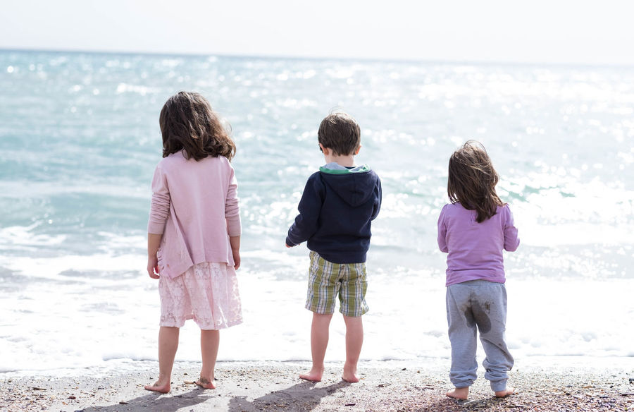 EmNewHere Kids Child Beach Sea #children #sea #beach #Child #childhood Full Length Females Friendship Togetherness Curly Hair Sister Family With Three Children Family Wave This Is Family