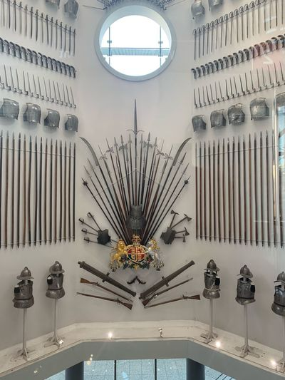 Heraldic Crest Crest Medieval Weapons Weapons Weaponry Museum EyeEm Selects Architecture Built Structure Indoors  No People Lighting Equipment Chandelier Hanging Decoration Ceiling Illuminated Shape Wall - Building Feature Circle Building Window Geometric Shape Mirror Day
