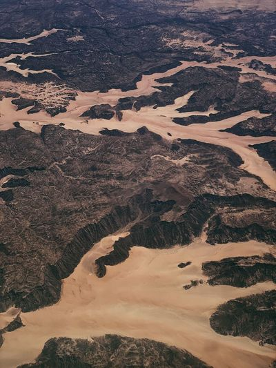 Dry riverbeds, canyons and desert in saudi arabia taken from an aircraft.