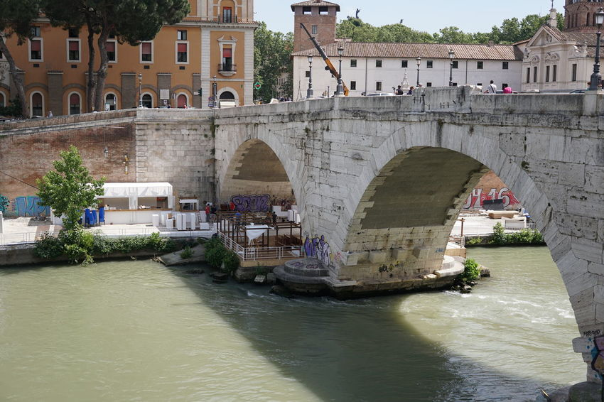 """Pons Cestius, meaning """"Cestius' Bridge"""", a Roman stone bridge in Rome, Italy, spanning the Tiber to the west of the Tiber Island Historical Building Pons Cestius Rome Tiber River Arch Arch Bridge Arched Architecture Bridge Bridge - Man Made Structure Building Exterior Built Structure Connection Historic History Outdoors River River Tiber Rome Italy Tiber Tiber Island Tiber Island Rome Tiber River Rome Water Waterfront"""