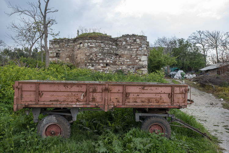 Plant Mode Of Transportation Transportation Tree Sky Day Land Vehicle Land Field Nature Abandoned Old Grass No People Damaged Architecture Decline Rural Scene Landscape Deterioration Outdoors Ruined