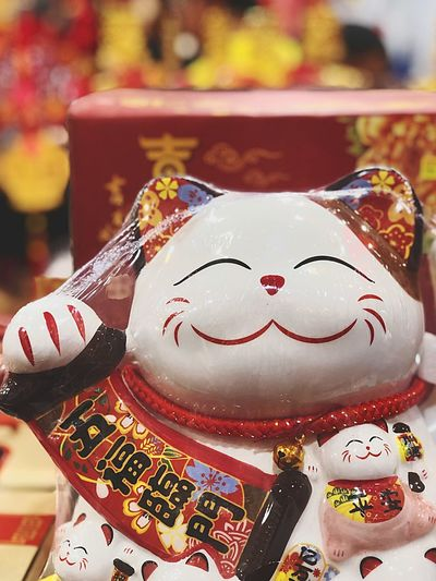 Fortune Cat Chinese New Year Fortune Cat Cat Human Representation Celebration Close-up Art And Craft Focus On Foreground Indoors  No People For Sale Festival