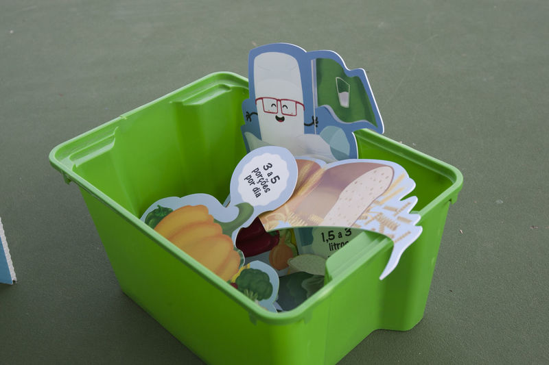 Green Color Still Life No People High Angle View Communication Text Western Script Container Indoors  Cup Number Plastic Large Group Of Objects Group Of Objects Close-up Day Group Finance Table Lunch Box