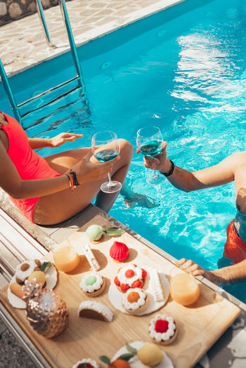 High angle view of people sitting in swimming pool