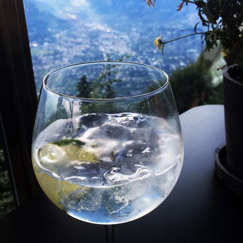 Close-up of drink on table against window