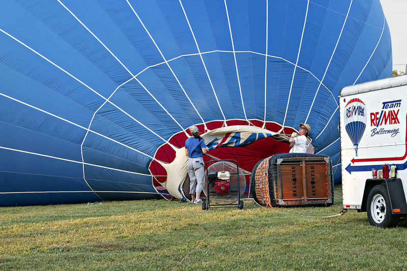 EyeEm Gallery Adventure Air Vehicle Balloon Car Day Field Grass Hot Air Balloon Land Land Vehicle Leisure Activity Men Mode Of Transportation Motor Vehicle Nature Outdoors People Real People Transportation Travel