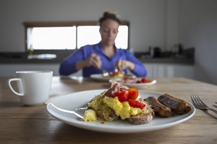 Man having breakfast served on table at home