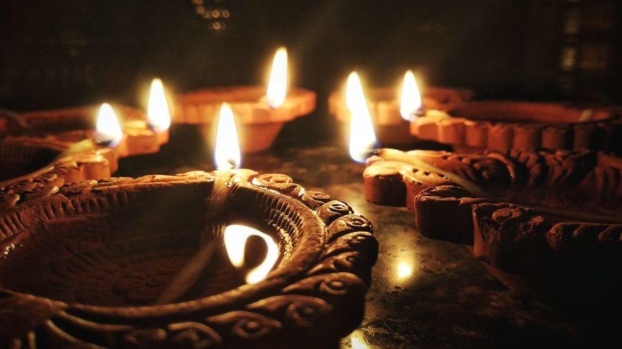 Close-Up Of Lit Diyas On Table During Diwali