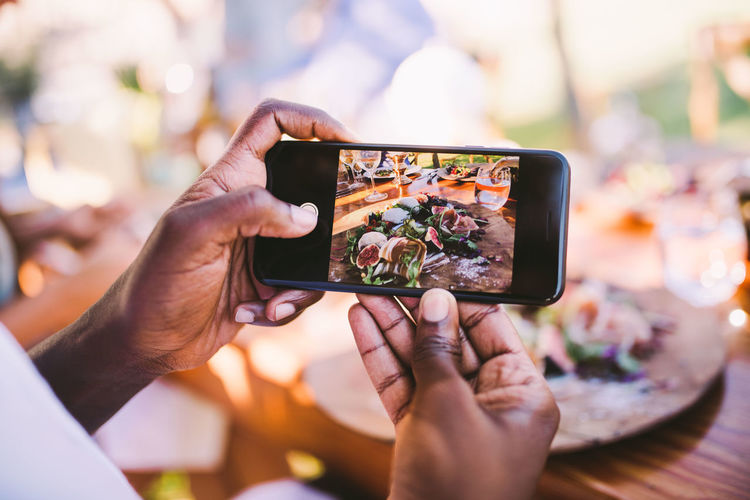 Close-up of person photographing food
