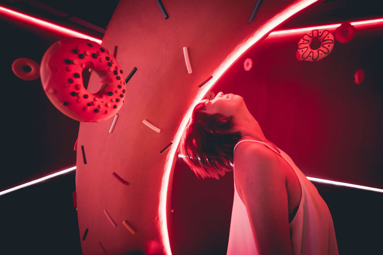 Portrait of woman with red light painting