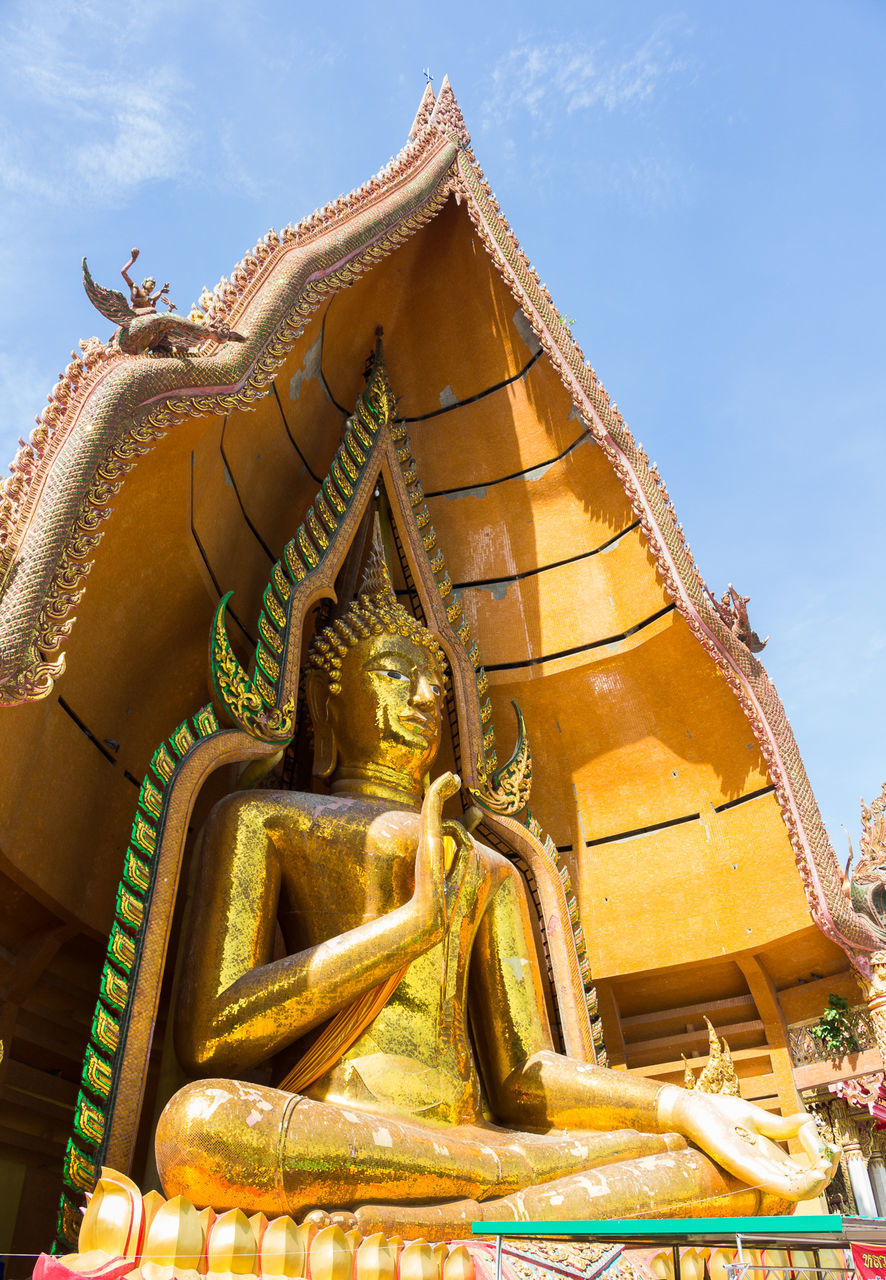 LOW ANGLE VIEW OF BUDDHA STATUE AGAINST BUILDING