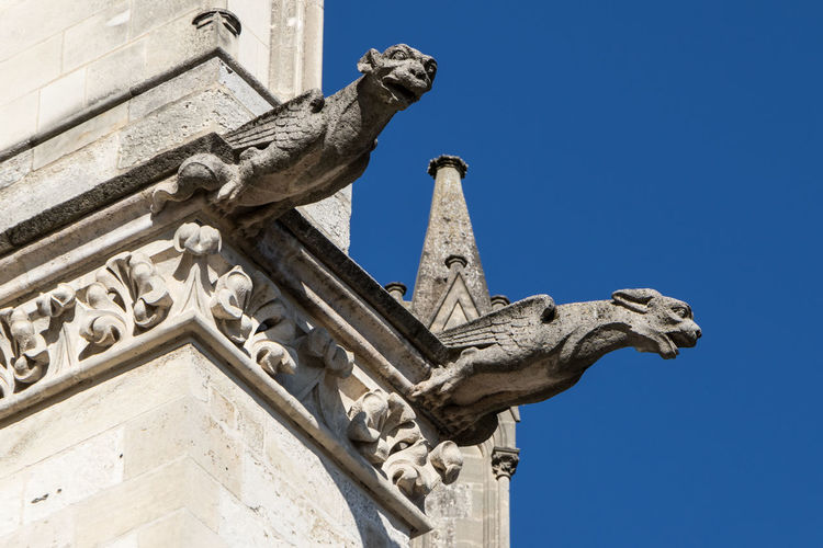 Gargoyles of Cathedral of Amiens Amiens France Amiens Cathedral Gargoyle Sculpture Architecture Statue Art And Craft Low Angle View Representation Built Structure History The Past Building Exterior No People Craft Human Representation Day Creativity Sky Male Likeness Stone Material Outdoors