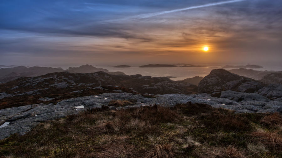 Sunset off Turøy Sky Scenics - Nature Mountain Beauty In Nature Sunset Tranquil Scene Tranquility Cloud - Sky Environment Nature Landscape No People Sun Idyllic Mountain Range Non-urban Scene Rock Outdoors Remote Mountain Peak Dusk Landscape_Collection Islands