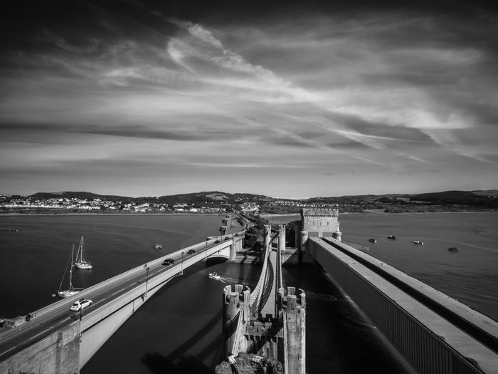 Three Bridges over the Afon Conwy, Conwy, North Wales. Beach Blackandwhite Built Structure Cloud Cloud - Sky Cloudy Day High Angle View Monochrome Nature Nautical Vessel North Wales Railing River Scenics Sea Shore Sky Tranquil Scene Tranquility Transportation Water Wood - Material