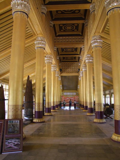 Palace of Kanbawzathadi (Built 1553), Bago Ancient Architecture Architectural Columns Architecture Assembly Hall Bago Buddhist Architecture Built Structure Distant Perspective Famous Place Gold Coloured History Illuminated Kings And Queens Long Hallway Low Angle View Meeting Place Myanmar No People Palace Place Of Worship Tourist Attraction  Tourist Destination Travel Destinations Unusual Wooden Construction