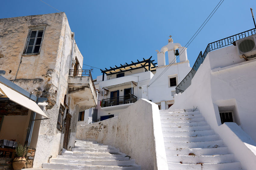 Naxos Naxos Town Stairs Alley Architecture Building Building Exterior Built Structure Clear Sky Day Direction House Low Angle View Nature No People Outdoors Residential District Sky Staircase Steps And Staircases Sunlight The Way Forward White Color Window