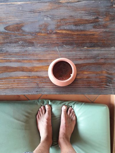 EyeEmNewHere barefoot Body Part Cup Directly Above Human Body Part Indoors  Low Section One Person Paz Personal Perspective Real People Relax Table Wood - Material The Traveler - 2018 EyeEm Awards The Still Life Photographer - 2018 EyeEm Awards