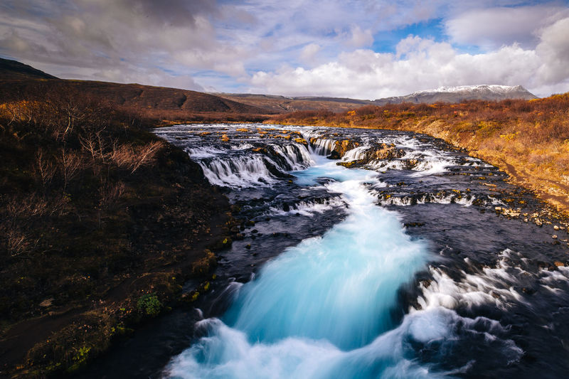 Scenics - Nature Water Beauty In Nature Sky Waterfall Cloud - Sky Motion Nature Mountain Flowing Water Non-urban Scene No People Environment Rock Rock - Object Landscape Long Exposure Flowing Blurred Motion Outdoors Power In Nature Iceland