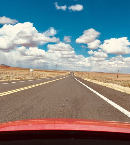 Cloud - Sky Sky Road Transportation Road Marking Marking Symbol Direction The Way Forward Day vanishing point Nature Sign Tranquil Scene Diminishing Perspective Beauty In Nature Empty Road Environment Tranquility